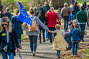 People arrive and walk through an autumnal Green Park - The People's Vote March For The Future demanding a Vote on any Brexit deal. The protest assembled on Park Lane and then marched to Parliament Square for speeches.