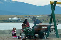 Refuges Living Rough on the Street of Puerto Natales Cooking Lunch. Snapshot taken with a Leica V-Lux 20 camera (ISO 80, 49.2 mm, f/4.9, 1/250 sec).