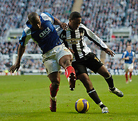Photo: Jed Wee.<br /> Newcastle United v Portsmouth. The Barclays Premiership. 26/11/2006.<br /> <br /> Newcastle's Charles N'Zogbia (R) tussles with Portsmouth's Noe Pamarot.