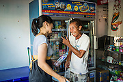 28 MARCH 2013 - BANGKOK, THAILAND:   Michelle Kao buys a drink in a small convenience store in her neighborhood.   PHOTO BY JACK KURTZ