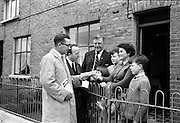 23/05/1963<br /> 05/23/1963<br /> 23 May 1963<br /> Mayor of Cork canvasses for Dublin Bye-Election. Alderman Sean Casey T.D. mayor of Cork (left) joined in the Labour Party canvassing for their candidate in the Dublin North-East Bye Election, Councillor Denis Larkin (3rd from left) while passing through Dublin on his way to London. Photo shows when he called with  Councillor Michael Mullins T.D. (2nd from left), at the home of Mrs Michael Lalor, 8 Ardilaun Square, Ballybough, Dublin with her children Michael, Eamonn, Catherine and Mary.