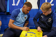 AFC Wimbledon attacker Julien Lamy (17) and AFC Wimbledon Jack Rudoni (12) signing AFC Wimbledon shirt during the EFL Sky Bet League 1 match between AFC Wimbledon and Blackpool at the Cherry Red Records Stadium, Kingston, England on 22 February 2020.