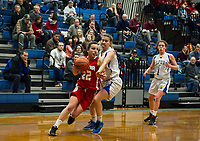 Laconia's Delia Cormier and Gilford's Olivia Trindade take the court for the girls finals of the holiday basketball tournament Friday evening.  (Karen Bobotas/for the Laconia Daily Sun)
