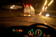 Seen through its windscreen, a car travels at speed along the M1 motorway behind an Eddie Stobart lorry.