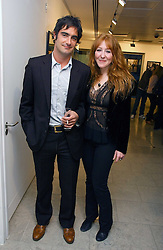 VISCOUNT CASTLEREAGH and CHARLOTTE TILBURY at an exhibition of photographs entitled 'Protect The Human' by photographers Jake Gavin and Sean Gleason commissioned by Amnesty Internationlal and held at The Hospital, 24 Endell Street, London WC2 on 31st May 2006.<br /><br />NON EXCLUSIVE - WORLD RIGHTS
