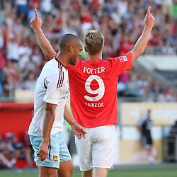 20.07.2013, Coface Arena, Mainz, GER, Testspiel, 1. FSV Mainz 05 vs West Ham United, im Bild Sebastian Polter (Mainz) feiert sein Tor...Winston Reid (West Ham United WHUFC) ist verzweifelt,,  // during the Friendly Match between 1. FSV Mainz 05 and West Ham United at the Coface Arena, Mainz, Germany on 2013/07/20. EXPA Pictures © 2013, PhotoCredit: EXPA/ Eibner/ Bildpressehaus<br /> <br /> ***** ATTENTION - OUT OF GER *****