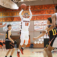 Gallup's Isaac Bustinza (12) takes a jump shot inside the paint against Espanola Valley Thursday night in Gallup.