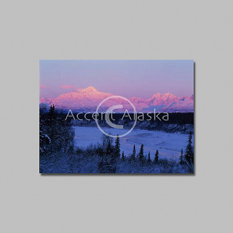 Alaska. Denali State Park. Alpenglow in Mt McKinley with the Chulitna River in foreground.