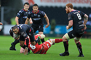 Eli Walker of the Ospreys (l) looks to break past the tackle from Morgan Allen of the Scarlets. Guinness Pro12 rugby match, Ospreys v Scarlets at the Liberty Stadium in Swansea, South Wales on Saturday 26th March 2016.<br /> pic by  Andrew Orchard, Andrew Orchard sports photography.