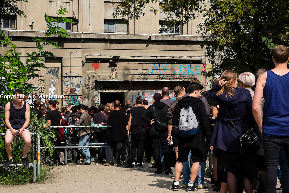 Clubbers queuing outside Berghain nightclub on a Sunday afternoon in Berlin Germany - Editorial Use Only