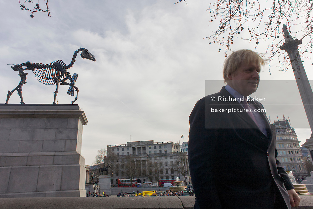 London Mayor Boris Johnson in Trafalgar Square. As the sculpture known as Gift Horse, by German artist Hans Haacke, is unveiled in London's Trafalgar Square on the public space called the Fourth Plinth. Johnson financed the 10th artwork to appear here. The skeletal, riderless horse (derived from The Anatomy of a Horse - George Stubbs, 1766) with a London Stock Exchange tickertape is a comment on power, money and history.