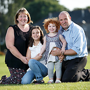 +++ For SUNDAY MAIL +++<br /> Carol-Anne Campbell, her husband Morris and two daughters Molly 9 and Lily 2 enjoy the summer sunshine near their home in Kirkintilloch. Both girls were born through IVF. <br /> Picture Robert Perry for The Sunday Mail 18th Aug 2016<br /> <br /> Must credit photo to Robert Perry<br /> FEE PAYABLE FOR REPRO USE<br /> FEE PAYABLE FOR ALL INTERNET USE<br /> www.robertperry.co.uk<br /> <br /> NB -This image is not to be distributed without the prior consent of the copyright holder.<br /> in using this image you agree to abide by terms and conditions as stated in this caption.<br /> All monies payable to Robert Perry<br /> <br /> (PLEASE DO NOT REMOVE THIS CAPTION)<br /> This image is intended for Editorial use (e.g. news). Any commercial or promotional use requires additional clearance. <br /> Copyright 2016 All rights protected.<br /> first use only<br /> contact details<br /> Robert Perry     <br /> 07702 631 477<br /> robertperryphotos@gmail.com<br />        <br /> Robert Perry reserves the right to pursue unauthorised use of this image . If you violate my intellectual property you may be liable for  damages, loss of income, and profits you derive from the use of this image.