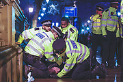 January 31, 2020, London, England, United Kingdom: Police apprehend and arrest a Brexit supporter nearby Downing Street entrance as he was shouting racists remarks towards their colleagues in London on Jan. 31, 2020. (Photo/Vudi Xhymshiti).The UK is leaving EU meanwhile the rise of hate crime is hitting up. The Home Office saw an increase of Hate Crime in Britain in 2019 up to 11%. Transgender hate crime went up 37% to 2,333. For sexual orientation the rise was 25% to 14,491, for disability 14% to 8,256 and for religion 3% to 8,566. (Credit Image: © Vedat Xhymshiti/ZUMA Wire)