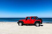 Parked SUV, Long Point Beach, Nantucket, Massachusets, USA.