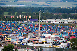 View towards the campsite. Ed Sherran on the main stage, seen from the Giant Wheel, Friday T in the Park 2014.<br /> © Michael Schofield.