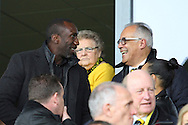 Former Burton Albion manager Jimmy Floyd Hasselbaink talks with Burton chairman Ben Robinson during the Sky Bet League 1 match between Burton Albion and Oldham Athletic at the Pirelli Stadium, Burton upon Trent, England on 26 March 2016. Photo by Aaron Lupton.