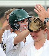 LYONS, PA - JUNE 09: Lansdale Catholic's Greta Sheridan is congratulated after hitting a home run during the PIAA Class AAA softball semifinal June 9, 2014 Lyons, Pennsylvania. Bethlehem won 4-1. (Photo by William Thomas Cain/Cain Images)