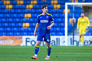 AFC Wimbledon midfielder Alex Woodyard (4) during the EFL Sky Bet League 1 match between AFC Wimbledon and Hull City at Plough Lane, London, United Kingdom on 27 February 2021.