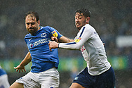 Portsmouth Forward, Brett Pitman (8) and Portsmouth Defender, Lee Brown (3) challenge for the ball during the EFL Sky Bet League 1 match between Portsmouth and Wycombe Wanderers at Fratton Park, Portsmouth, England on 22 September 2018.
