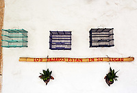 empty bird cages standing on the wall with this spanish sentence the birds are in their place