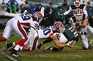 PHILADELPHIA - DECEMBER 30: Kevin Curtis #80 of the Philadelphia Eagles is taken down by Chris Kelsay #90 of the Bills during the game against the Buffalo Bills on December 30, 2007 at Lincoln Financial Field in Philadelphia, Pennsylvania. The Eagles won 17-9.