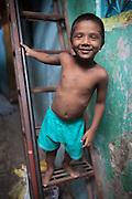 Boy on a Ladder - Dharavi, Mumbai, India