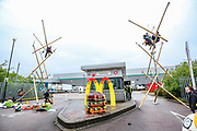 London, United Kingdom, May 22, 2021: About 50+ protestors gathered outside McDonald's distribution centre in Hampstead Industrial estate in North London on the early morning of Saturday, May 22, 2021 - to blockade the site for at least 24 hours, using trucks and bamboo structures, causing a significant disruption to the McDonald's supply chain. (Photo by Vudi Xhymshiti)