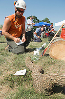 Zack West of ZD Tree Service in Gilford competes in the Tree Identification event on Sunday during the 2012 Gilford Bicentennial Woodsman Competition.  (Karen Bobotas/for the Laconia Daily Sun)