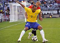 Fotball<br /> Brasil v Egypt<br /> Foto: DPPI/Digitalsport<br /> NORWAY ONLY<br /> <br /> FOOTBALL - CONFEDERATIONS NATIONS CUP 2009 - GROUP B - 1ST ROUND - BRAZIL v EGYPT - 15/06/2009 <br /> <br /> LUIS FABIANO (BRA) / WAEL GOMAA (EGY)