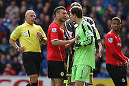 Steven Caulker of Cardiff city and Stoke city goalkeeper Asmir Begovic have a disagreement, while referee Howard Webb runs over to intervene. Barclays Premier league match, Cardiff city  v Stoke city at the Cardiff city stadium in Cardiff, South Wales on Saturday 19th April 2014. pic by Mark Hawkins, Andrew Orchard sports photography,