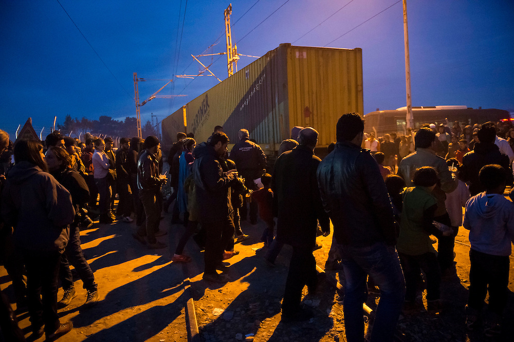 March 5, 2016 - Idomeni, Greece:  regugees pass after a train came by through the make shift refugee camp at the  Idomeni border crossing in Greece. 13,000 refugees are stuck here after Macedonia closed the border. New arrivals come in every day, making living conditions more and more difficult. (Steven Wassenaar/Polaris)