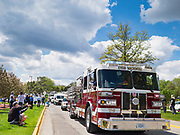 """06 MAY 2020 - DES MOINES, IOWA: First responders drive past Unity Point Health Iowa Methodist Medical Center in Des Moines during the """"appreciation loop"""". Des Moines first responders, the Iowa State Patrol, and utility companies made an """"Appreciation Loop"""" around Des Moines hospitals on National Nurses' Day to thank nurses and other care givers at the hospital for the care they are providing during the COVID-19 (Coronavirus/SARS-CoV-2) pandemic. Iowa reported 10,404 confirmed cases of COVID-19 statewide Wednesday, about 2,500 cases in the Des Moines metropolitan area. Acting against the advice of many medical professionals, the Governor of Iowa has started reopening businesses in the state. Businesses in the Des Moines area, and other communities with a high number of cases are not allowed to reopen.           PHOTO BY JACK KURTZ"""