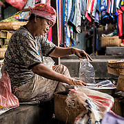 INDONESIA. Tulamben, Bali. June 2nd, 2013. A local market woman makes a modest living selling fresh vegetables, fruits and spices. A stroll through the many marketplaces of Amalpura is a humbling cultural experience.