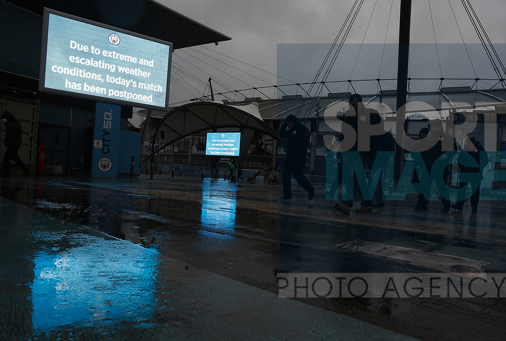 Workers leave after the Premier League match between Manchester City and West Ham United was postponed because of weather conditions at the Etihad Stadium, Manchester. Picture date: 9th February 2020. Picture credit should read: Darren Staples/Sportimage