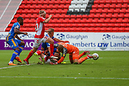 Charlton Athletic goalkeeper Dillon Phillips (1) is beaten by a shot by Shrewsbury Town Greg Docherty (8). However his shot is cleared off the line by Charlton Athletic midfielder Chris Solly (20) during the EFL Sky Bet League 1 match between Charlton Athletic and Shrewsbury Town at The Valley, London, England on 11 August 2018.