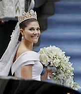 Sweden's Crown Princess Victoria arrive for the wedding ceremony on June 19, 2010. AFP PHOTO / DANIEL SANNUM LAUTEN