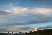 The last rays of daylight illuminate the Grand Teton on a July evening in Teton Valley, Idaho.