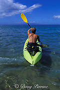 diver heads out for dive with scuba gear <br /> in back of kayak, 4 Seasons Resort, <br /> Wailea, Maui, Hawaii, USA ( Pacific )  MR 294