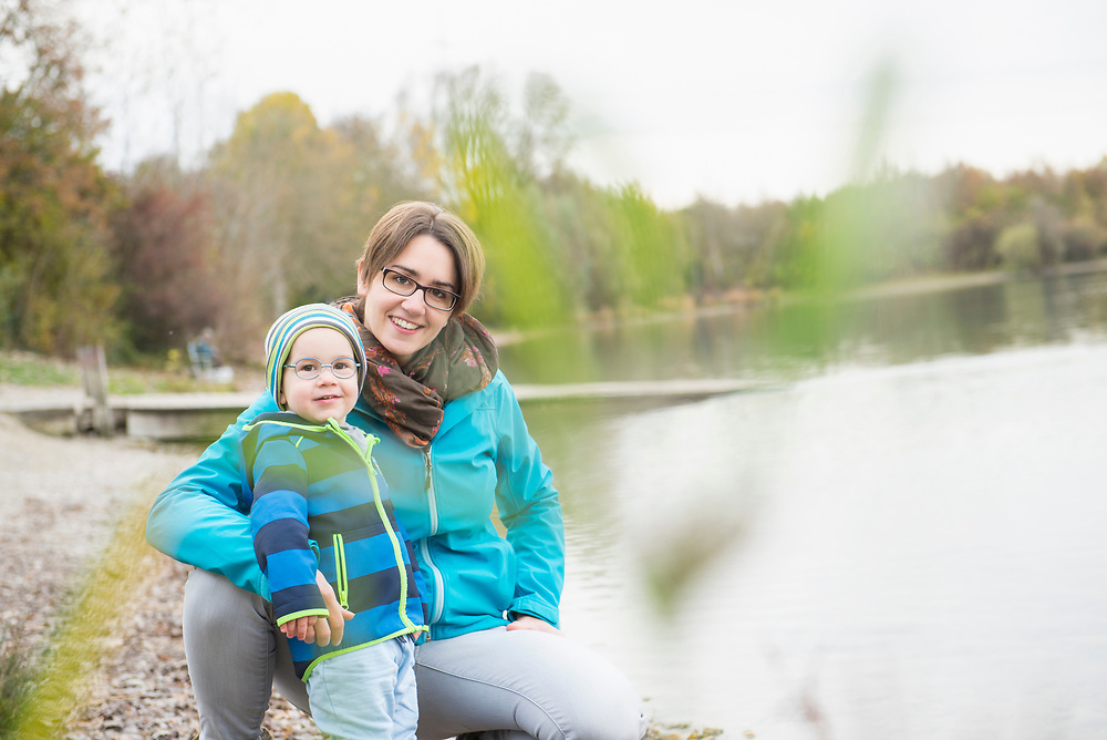 Portrait of mother with son on lakeshore