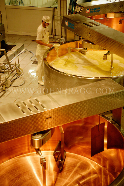 A view of Gruyere Cheese mixing at the La Gruyere Cheese Factory, Pingy/Gruyere, Switzerland