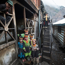 Bumburet, Chitral District,Pakistan.Pic Shows Kalash kids in the Kalash village in the valley of Bumburet making some traditional clothing