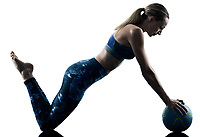 one caucasian woman exercising fitness Medicine Ball excercises in silhouette isolated on white background
