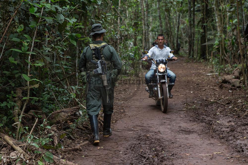 El Diamante, Meta, Colombia - 19.09.2016        <br /> <br /> Guerilla camp during the 10th conference of the marxist FARC-EP in El Diamante, a Guerilla controlled area in the Colombian district Meta. Few days ahead of the peace contract passing after 52 years of war with the Colombian Governement wants the FARC decide on the 7-days long conferce their transformation into a unarmed political organization. <br /> <br /> Guerilla-Camp zur zehnten Konferenz der marxistischen FARC-EP in El Diamante, einem von der Guerilla kontrollierten Gebiet in der kolumbianischen Region Meta. Wenige Tage vor der geplanten Verabschiedung eines Friedensvertrags nach 52 Jahren Krieg mit der kolumbianischen Regierung will die FARC auf ihrer sieben taegigen Konferenz die Umwandlung in eine unbewaffneten politischen Organisation beschließen. <br />  <br /> Photo: Bjoern Kietzmann