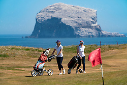 North Berwick, Scotland, UK. 29 May 2020. Golfers playing at Glen Golf Club in North Berwick. With the Bass Rock a dramatic backdrop. Hot sunny weather and a relaxation of covid-19 lockdown rules in Scotland means golf can now be played. Numbers of players are limited to two per game. Iain Masterton/Alamy Live News
