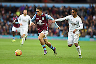 Jack Grealish of Aston Villa goes past Swansea's Kyle Naughton.  Barclays Premier league match, Aston Villa v Swansea city at Villa Park in Birmingham, the Midlands on Saturday 24th October 2015.<br /> pic by  Andrew Orchard, Andrew Orchard sports photography.