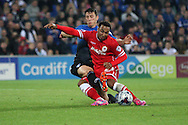 Nicky Maynard of Cardiff is tackled. Capital One Cup, 3rd round match, Cardiff City v AFC Bournemouth at the Cardiff City stadium in Cardiff, South Wales on Tuesday 23rd Sept 2014<br /> pic by Mark Hawkins, Andrew Orchard sports photography.