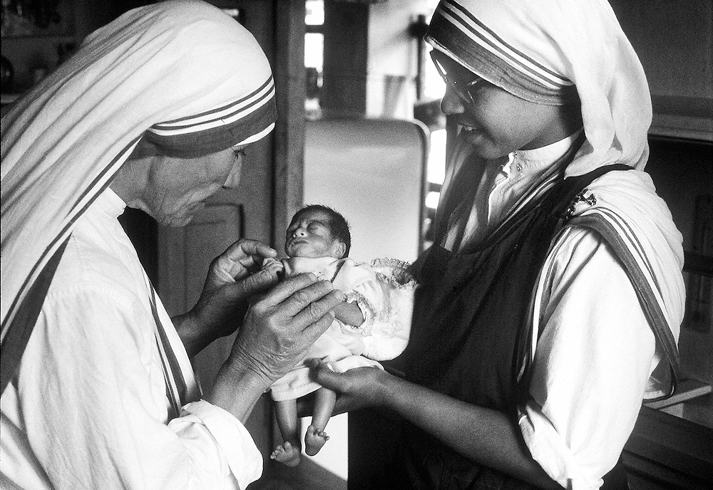 Mother Teresa seen with a small child at  the home for the destitute and dying in Calcutta,India in 1969. Photographed by Terry Fincher
