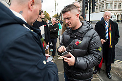 © Licensed to London News Pictures. 28/10/2015. London, UK. Former leader of the EDL, TOMMY ROBINSON (centre) at the demo. Former and serving members of the armed forces take part in a rally in support of support of Sgt Alexander Blackman, who was given a life sentence after being convicted of murdering a wounded Taliban fighter. Senior military officials have warned of possible disciplinary action against troops caught attending the event. Photo credit: Ben Cawthra/LNP