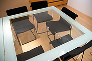empty chairs with glass top table