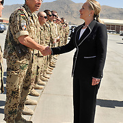 KABUL -- 7/7/12 -- U.S. Secretary of State Hillary Rodham Clinton greets German Army Colonel Hans Buhl of Munster, Germany while visiting Kabul International Airport enroute to Japan today. She greeted about 50 Sailors, Soldiers, Airmen and Marines along with their NATO counterparts.   U.S. Navy photo by Chief Mass Communication Specialist Roger S. Duncan (RELEASED)